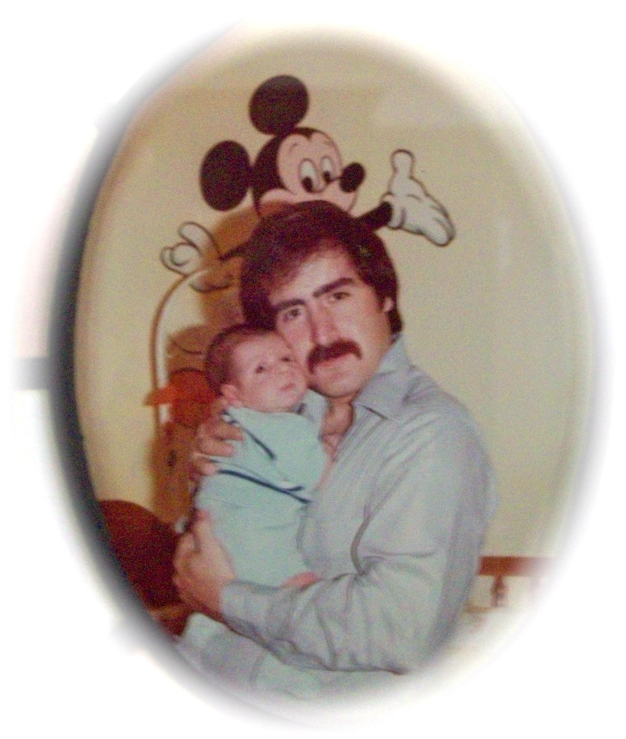 Dennis with a newborn Rob