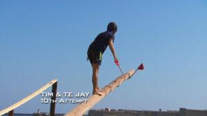 Tim grabbing a flag on a pole