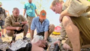 Jeff Probst and Dr. Joe tend to Caleb on Survivor Kaoh Rong